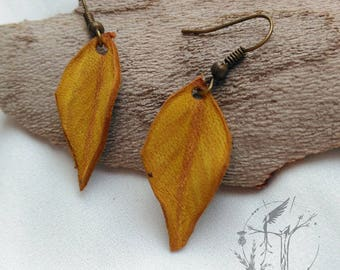 Slope of dry leaf. Autumn earring handmade leather.