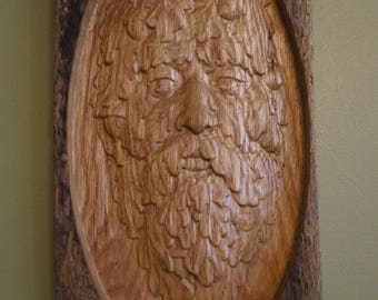 Green Man wall art on old growth oak barn board.