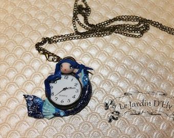 hanging Mermaid has his pocket watch