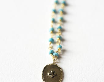 Turquoise necklace and medal