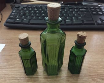 3 Green glass bottles with cork stoppers