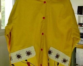 Yellow reversible raincoat 'Africa '.