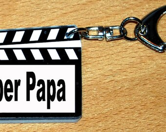 Keychain shape clap film with the super dad message