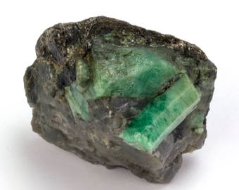Rough emerald of 65 grams on matrix.
