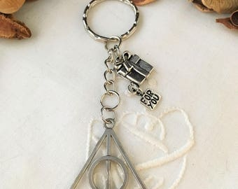 key shape triangle and circle symbol object magical relic of death in harry potter silver