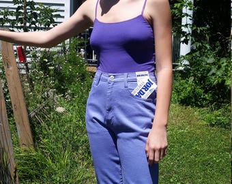 Dead stock 80's Jordache jeans. High waisted purple. Vintage size 10 stretch. Tapered leg.