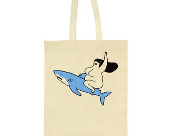 Woman Riding Shark Fast Tote Bag