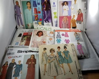 11 VTG packages of clothing patterns.  Many uncut.  Complete. Women's clothing. Various manufacturers, incl designer.   60's -90s.