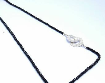 Necklace with black spinel gemstone and silver discs lock