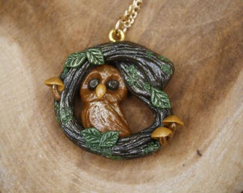 Owl necklace with a branch around him, polymer clay jewelry