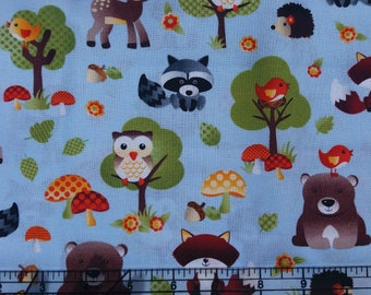 Baby Woodland Creatures on blue fabric