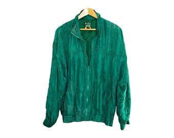 vintage Oleg Cassini silk bomber with piping detail in deep forest green from the 1980s