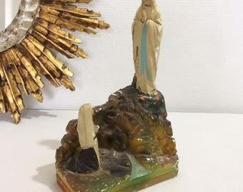 Plaster statue of Virgin Mary and Bernadette Soubirous. Lourdes
