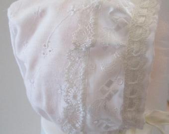 White cotton bonnet with delicate lace