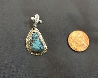 Natural Spiderweb Turquoise set in sterling silver