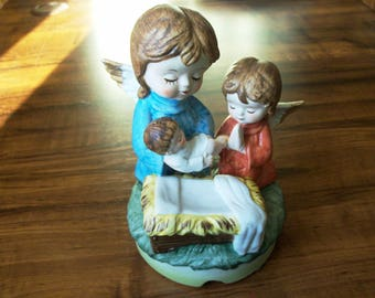 Vintage Porcelain Angels with baby Christmas musical box  (#EV159)