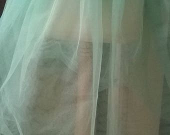 Ballerina in green tulle tutu skirt