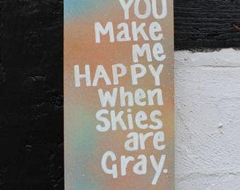 You make me happy when skies are gray, sign