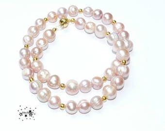 Pearl necklace of large freshwater cultured pearls