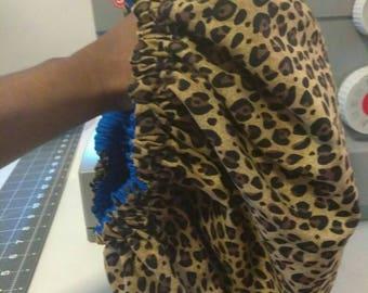 Cheetah print bonnet with royal blue lining