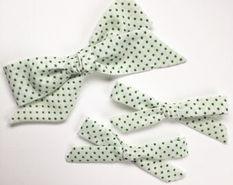 White and green swiss dot bow