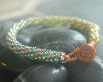 Serenity Beaded Kumihimo Braid Bracelet with Copper Button Loop Closure; Aqua Blue-to-Peridot Green Ombre with Copper Dots, Ohm Symbol
