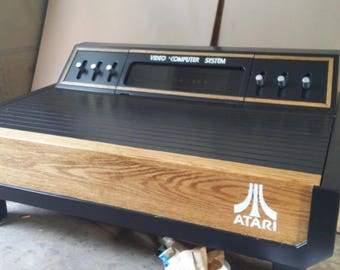 Atari 2600 5 piece furniture set with 100 games..limited availability