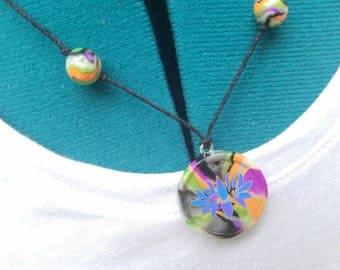 Handmade glow in the dark lotus flower clay necklace