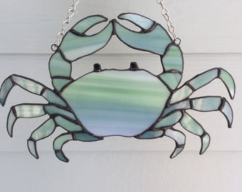 Blue-green stained glass crab