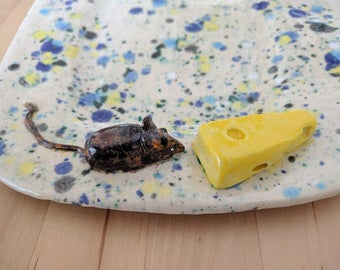 Metal plate with mouse and cheese