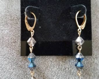 1.75 inch dangle pierced earrings in 3 sections for extra movement - Swarovski crystals.