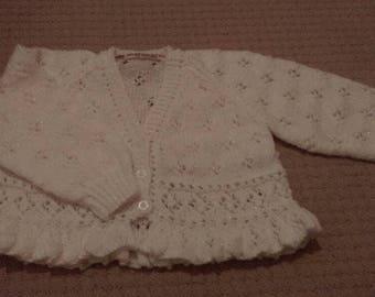 Beautiful lace effect white cardigan with peplum style bottom