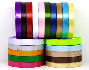 Black satin ribbon measuring 12 mm wide