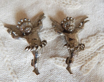 A Pair of Vintage Silvertone Cupid Cherub Clip Earrings - Large Size - Circa 1940s to 50s