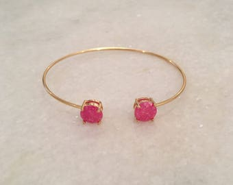 thin gold bracelet with pink stones