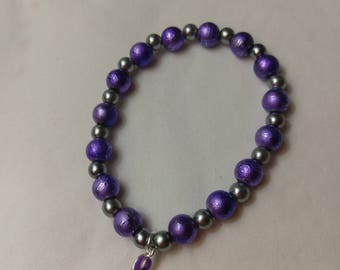 Domestic Violence Awareness stretch bracelet with Purple Ribbon Charm