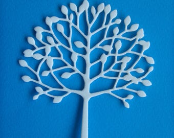 Cut little tree with leaves in sheet of white foam for scrapbooking and card