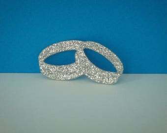 Cut two wedding rings intertwined silver glitter for creation