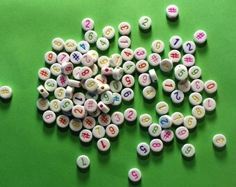 100 white figures multi-colored 7 mm round beads