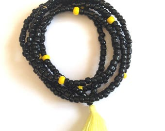 Seed beads in yellow tassel necklace.