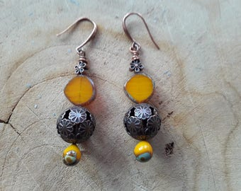 Pair of glass filled and copper earrings.