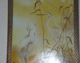 Hand painted porcelain wall plate: egrets in the middle of the reeds
