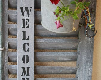 "Weathered wooden ""WELCOME"" sign"
