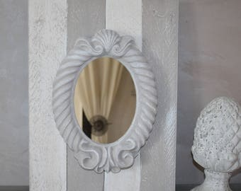 Romantic baroque mirror on natural wood