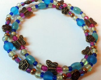"""""""Flowers and butterflies"""" Fuchsia and turquoise bracelet"""