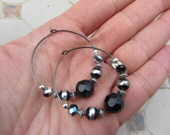 Earrings hoops and black and silver beads, faceted beads, gun metal