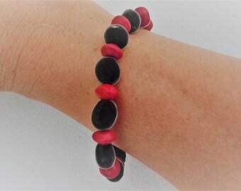 Elastic bicolor bracelet in zanzibar seeds and réglise