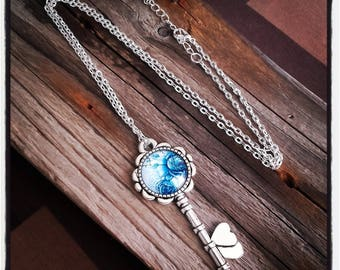 key and blue cabochon silver pendant necklace