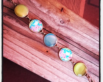 Bracelet of brass and 6 green and turquoise cabochons