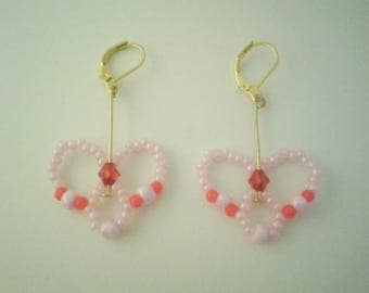 Dangling earrings with pink beads